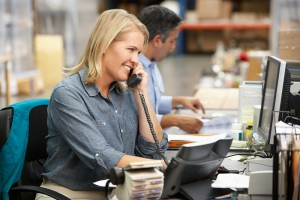 Woman on office phone_shutterstock_129614792