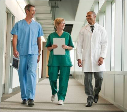 Three Medical Personnel Walking Easily Carrying A Medical Tablet